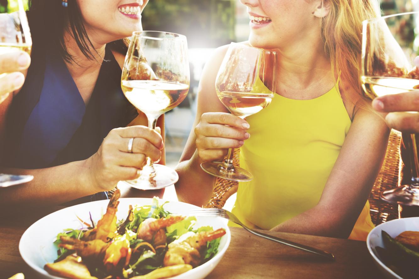 Friends enjoying wine and food